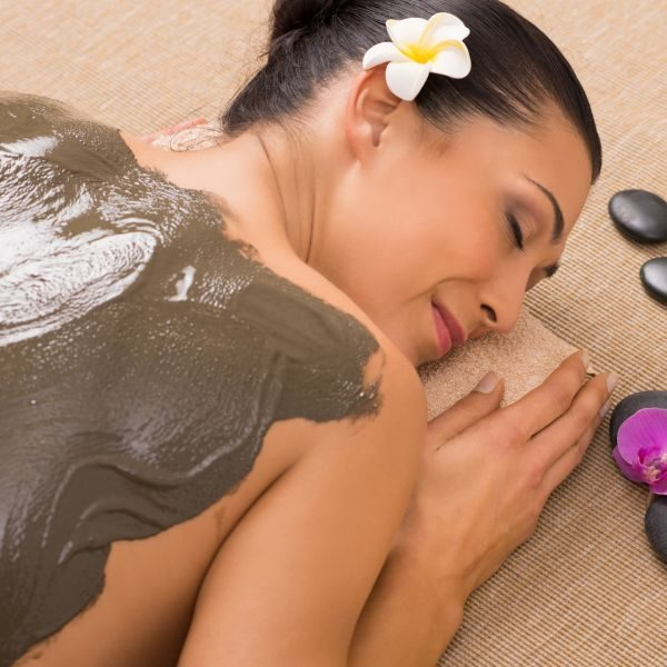 Relaxed Woman Receiving A Mud Treatment At Spa